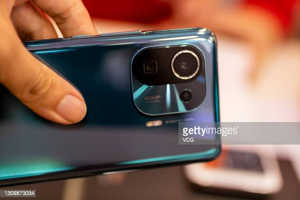 Mi 11 Pro smartphone is seen at a Xiaomi store on March 29, 2021 in Shaoxing, Zhejiang Province of China.