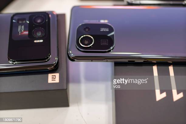 Mi 11 Ultra and Mi 11 Pro smartphones are on display at a Xiaomi store on March 29, 2021 in Shaoxing, Zhejiang Province of China.