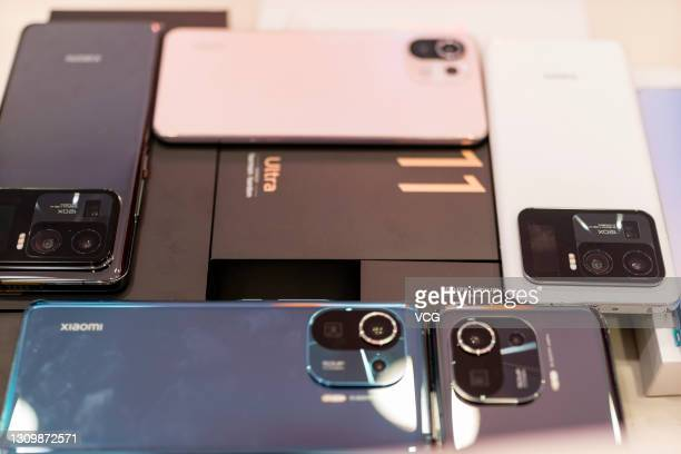 Mi 11 Ultra, Mi 11 Pro and Mi 11 Lite smartphones are on display at a Xiaomi store on March 29, 2021 in Shaoxing, Zhejiang Province of China.