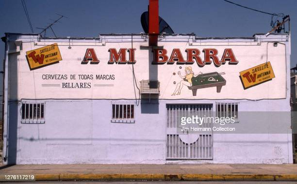 Mi Barra at 138 North San Fernando Road in the Lincoln Heights neighborhood of Los Angeles, California has an image of a woman sitting on a pool...