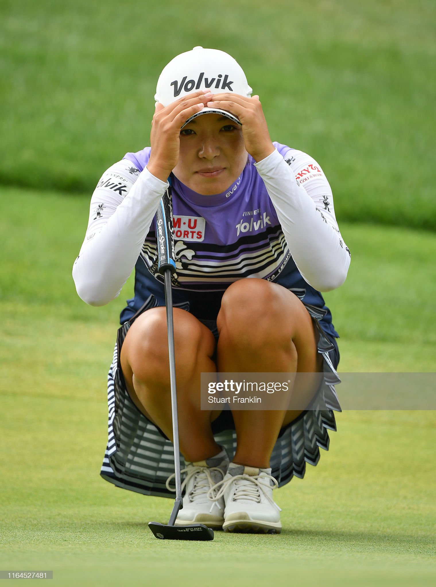 https://media.gettyimages.com/photos/mi-hyang-lee-of-korea-lines-up-a-putt-during-day-3-of-the-evian-at-picture-id1164527481?s=2048x2048