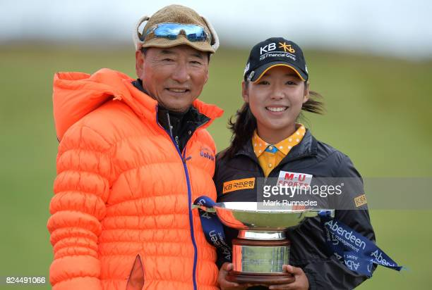 Mi Hyang Lee of Korea winner of the Aberdeen Asset Management Ladies Scottish Open poses for a photograph with her father as she lifts the trophy...