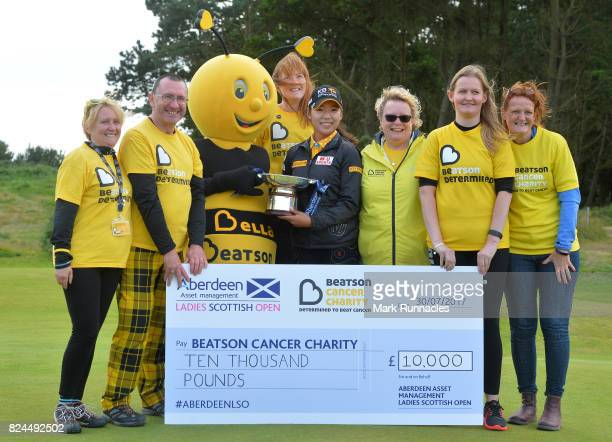 Mi Hyang Lee of Korea winner of the Aberdeen Asset Management Ladies Scottish Open poses for a photograph with a charity cheque after the final round...