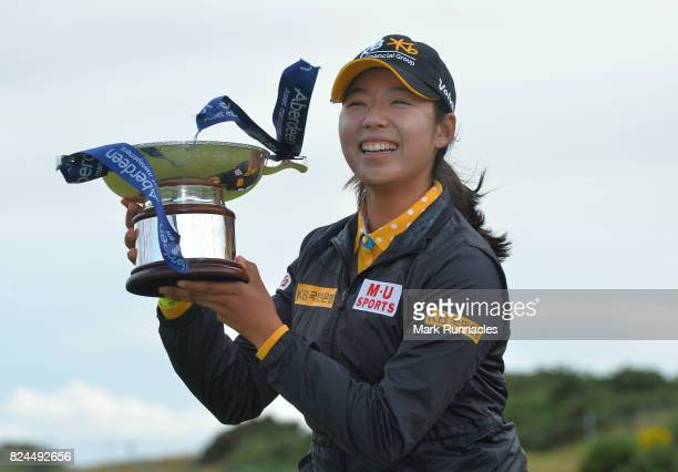 Mi Hyang Lee of Korea winner of the Aberdeen Asset Management Ladies Scottish Open lifts the trophy after the final round at Dundonald Links Golf...