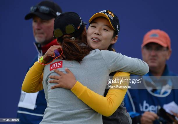 Mi Hyang Lee of Korea winner of the Aberdeen Asset Management Ladies Scottish Open is congratulated at the 18th green by Sun Young Yoo of Korea after...