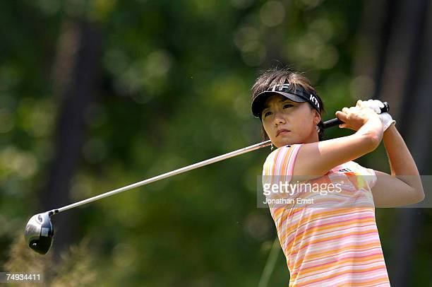 Mi Hyun Kim of Korea hits from the 6th tee during a practice round prior to the start of the US Women's Open Championship at Pine Needles Lodge Golf...