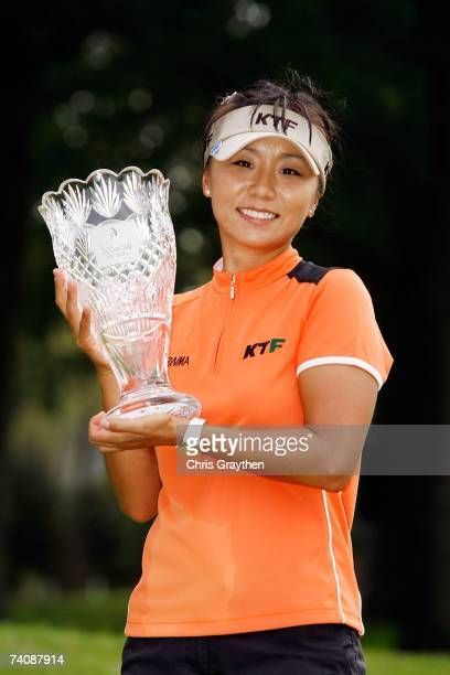 Mi Hyun Kim of South Korea holds the winner's trophy after beating Juli Inkster in a playoff during the final round of the SemGroup Championship...