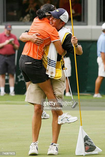 Mi Hyun Kim of South Korea hugs her caddy Jason Hamilton after winning the final round of the SemGroup Championship presented by John Q Hammons on...