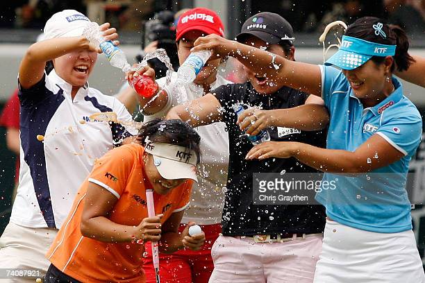 Mi Hyun Kim of South Korea is doused with water by other players after winning the final round of the SemGroup Championship presented by John Q...