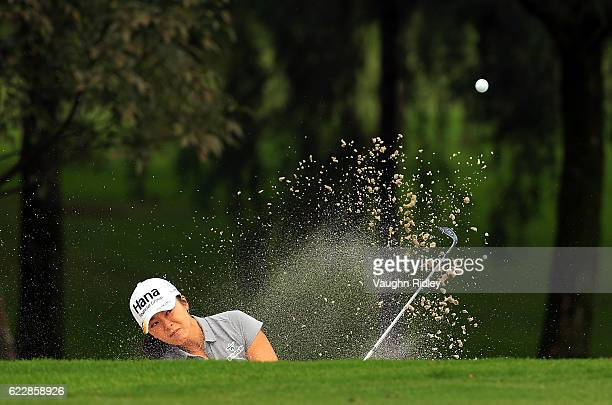 Mi Jung Hur of Korea hits out of the bunker on the 5th green during the third round of the Citibanamex Lorena Ochoa Invitational Presented By...
