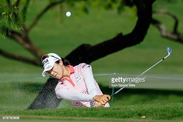 Mi Jung Hur of South Korea hits out of the bunker on during the final round of the Volunteers of America North Texas Shootout at Las Colinas Country...