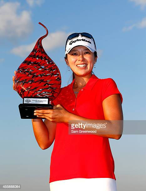 Mi Jung Hur of South Korea poses with the trophy after winning the Yokohama Tire LPGA Classic at the Robert Trent Jones Golf Trail at Capitol Hill...