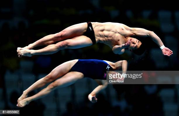 Mi Rae Kim of DPR Korea and Myong Hyon II of DPR Korea competes during the Mixed Diving 10m Synchro Platform Final on day two of the Budapest 2017...