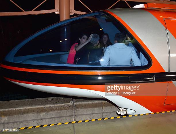Mia Alamuddin lawyer Amal Clooney actor George Clooney and The Walt Disney Company Chairman and CEO Bob Iger ride the monorail to the after party for...