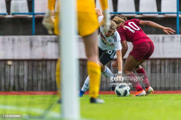 Mia Büchele of Germany is challenged by Lexi LloydSmith of England during the U16 Girl's Open Nordic Tournament final between Germany U16 Girl's and...