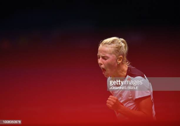 Mia Blichfeldt of Denmark reacts after a point against Ratchanok Intanon of Thailand in their women's singles match during the badminton World...
