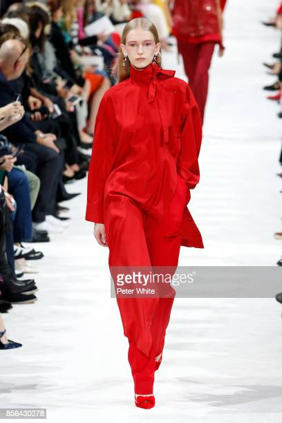 Mia Brammer walks the runway during the Valentino show as part of the Paris Fashion Week Womenswear Spring/Summer 2018 on October 1 2017 in Paris...