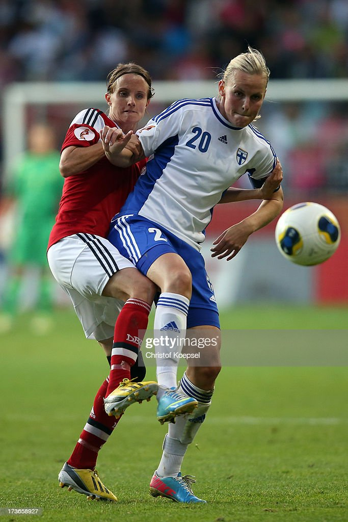 Mia Brogaard of Denmark challenges Annica Sjoelund of Finland during the UEFA Women's EURO 2013 Group A match between Denmark and Finland at Gamla Ullevi Stadium on July 16, 2013 in Gothenburg, Sweden.