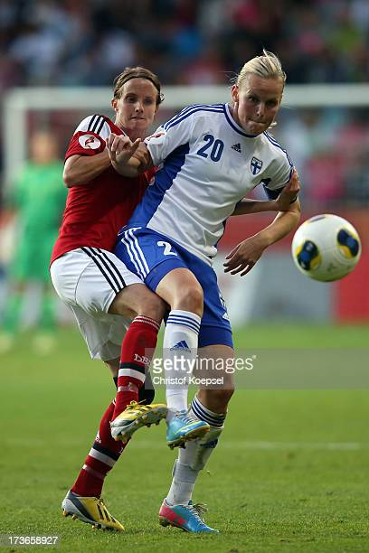 Mia Brogaard of Denmark challenges Annica Sjoelund of Finland during the UEFA Women's EURO 2013 Group A match between Denmark and Finland at Gamla...