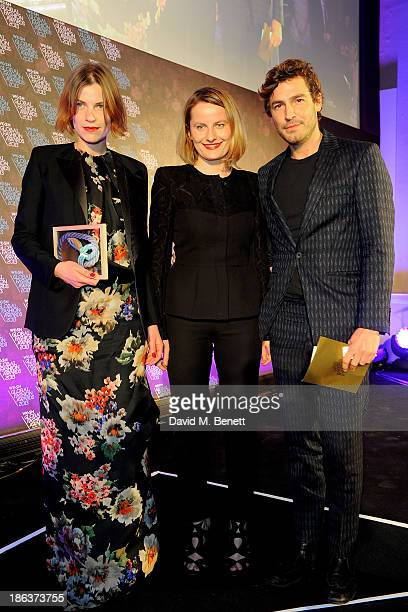 Mia Castenskjold and Ania Wiacek winners of the Menswear Design Team award and Robert Konjic pose onstage at The WGSN Global Fashion Awards at the...
