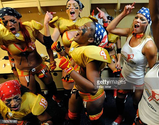 Mia Chambers and Las Vegas Sin teammates celebrate in the locker room after their 2820 Lingerie Football League game victory over the Los Angeles...