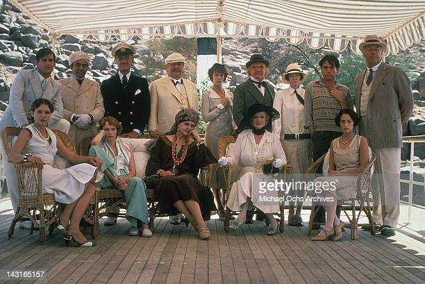 Mia Farrow David Niven Peter Ustinov Angela Lansbury Bette Davis Jack Warden Olivia Hussey George Kennedy and other cast members pose for picture in...