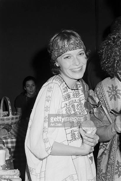 Mia Farrow holding an apple circa 1970 New York
