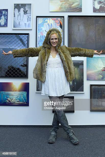 Mia Florentine Weiss in front of her artwork during In Between Exhibition Opening at Roedingsmarkt 9 on November 11 2014 in Hamburg Germany