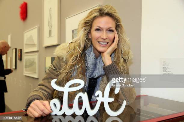 """Mia Florentine Weiss with her work of art """"Love"""" and """"Hate"""" during the PIN Party at Pinakothek der Moderne on November 24, 2018 in Munich, Germany."""