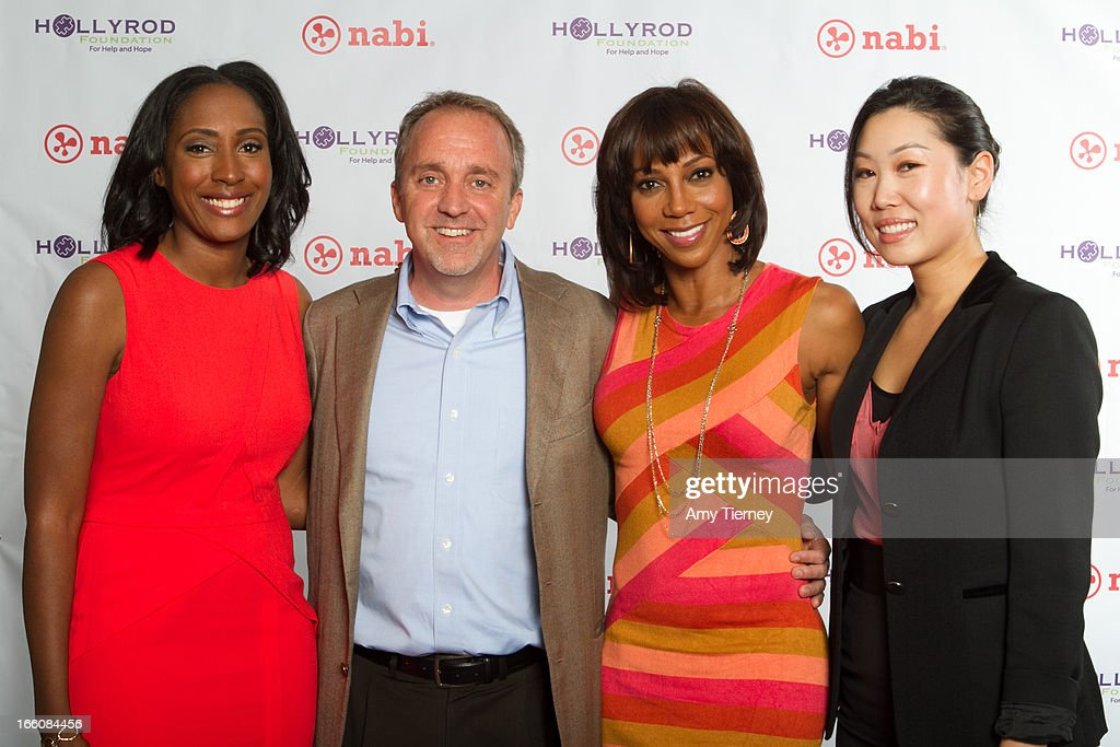 Mia Gorman, Jim Mitchell, CEO, Fuhu Inc., Holly Robinson Peete, and Lisa Lee, Director of Marketing and Communications, Fuhu Inc., gather for a donation on behalf of nabi to the HollyRod Foundation to help families living with autism at Fuhu, Inc. on April 7, 2013 in Los Angeles, California.