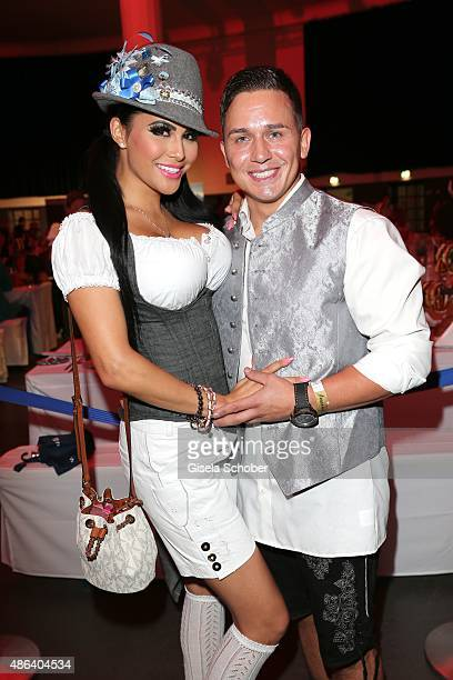 Mia Gray and her boyfriend Oliver Kobs during the Angermaier TrachtenNacht 2015 at Postpalast in Munich on September 3 2015 in Munich Germany