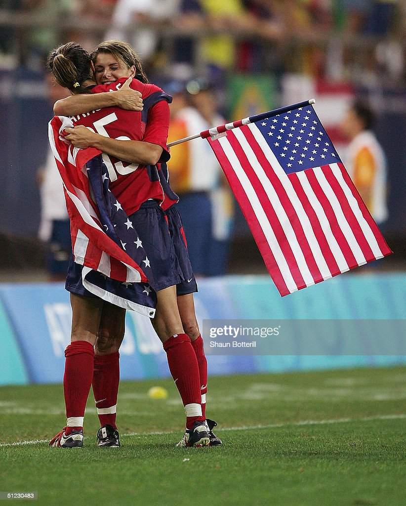 Mia Hamm (R) and Kate Markgraf embrace after victory in the women's football Gold Medal match on August 26, 2004 during the Athens 2004 Summer Olympic Games at Karaiskaki Stadium in Athens, Greece.