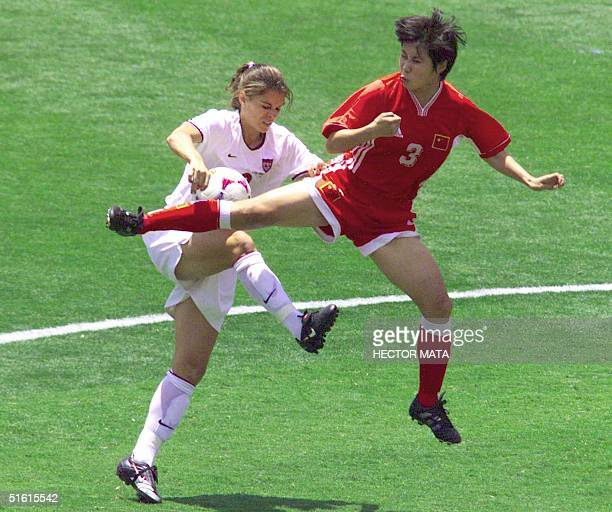 Mia Hamm of the US battles China's Fan Yunjie during the 10 July 1999 Women's World Cup final at the Rose Bowl in Pasadena California AFP...