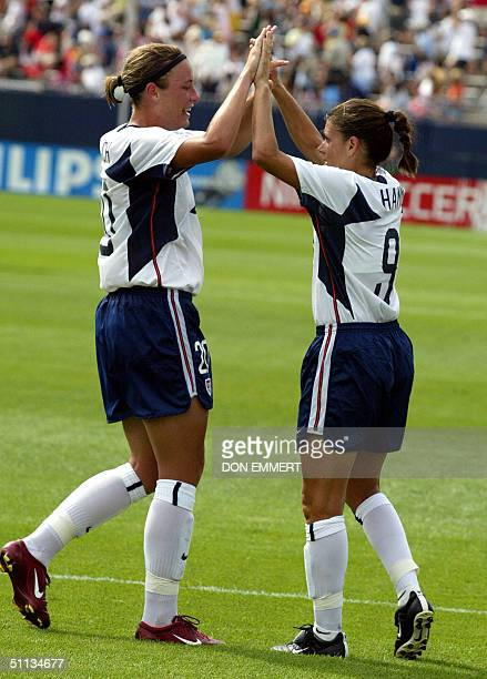 Mia Hamm of the US is congratulated by teammate Abby Wambach after scoring a goal during a friendly match between the China National Women's Soccer...