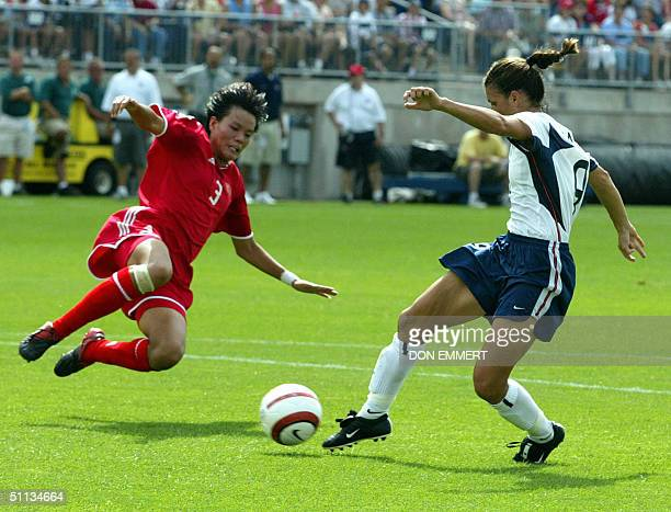 Mia Hamm of the US kicks a goal past Li Jie of China during a friendly match between the China National Women's Soccer team and the US Women's...