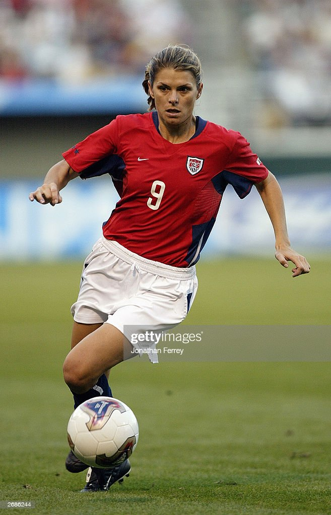 Mia Hamm #9 of the USA advances the ball against Germany during the semifinals of the FIFA Women's World Cup match on October 5, 2003 at PGE Park in Portland, Oregon. Germany defeated the U