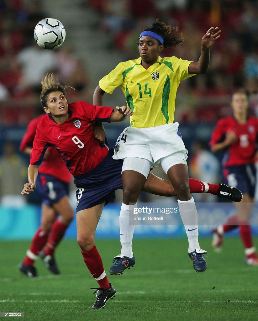 Mia Hamm of the USA and Elaine of Brazil compete for the ball in the women's football Gold Medal match on August 26, 2004 during the Athens 2004 Summer Olympic Games at Karaiskaki Stadium in Athens, Greece.