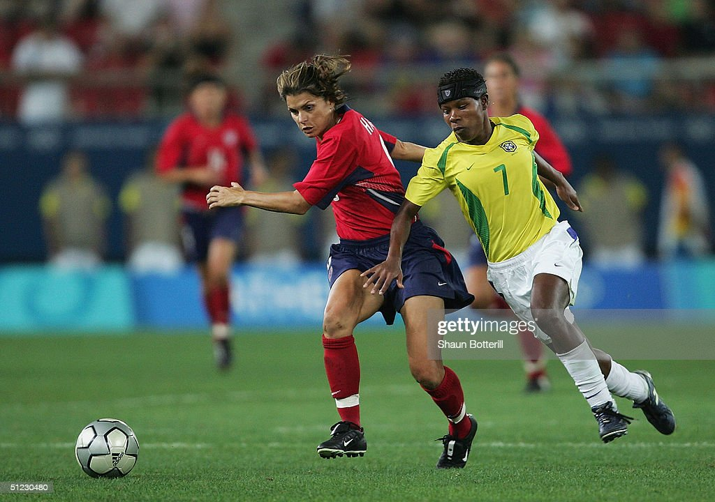 Mia Hamm of the USA and Formiga of Brazil compete for the ball during the women's football Gold Medal match on August 26, 2004 during the Athens 2004 Summer Olympic Games at Karaiskaki Stadium in Athens, Greece.