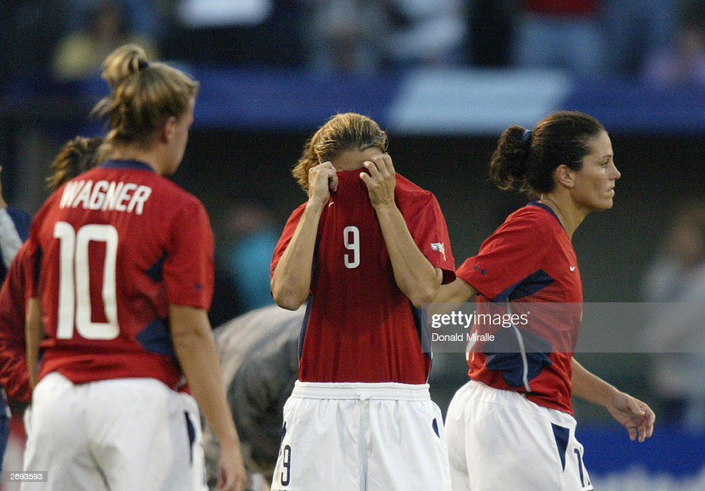 Mia Hamm #9 of the USA and teammates react to being defeated 3-0 by Germany in the semifinals of the FIFA Women's World Cup match on October 5, 2003 at PGE Park in Portland, Oregon. Germany defeated the U