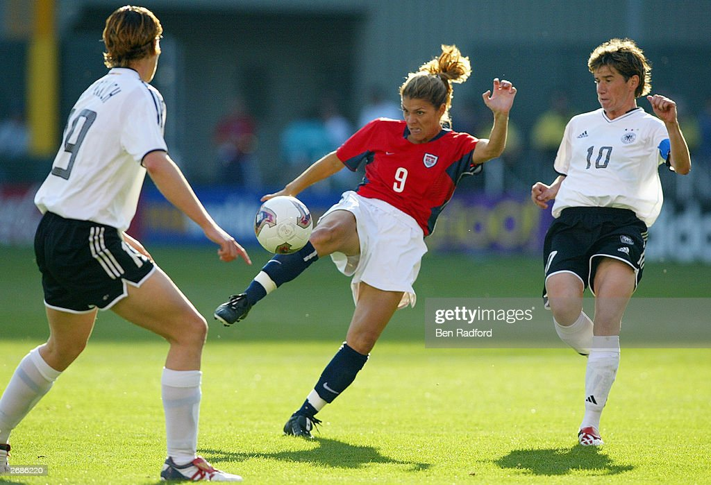 Mia Hamm #9 of the USA kicks against the defense of Germany during the semifinals of the FIFA Women's World Cup match on October 5, 2003 at PGE Park in Portland, Oregon. Germany defeated the U