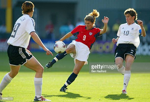 Mia Hamm of the USA kicks against the defense of Germany during the semifinals of the FIFA Women's World Cup match on October 5 2003 at PGE Park in...