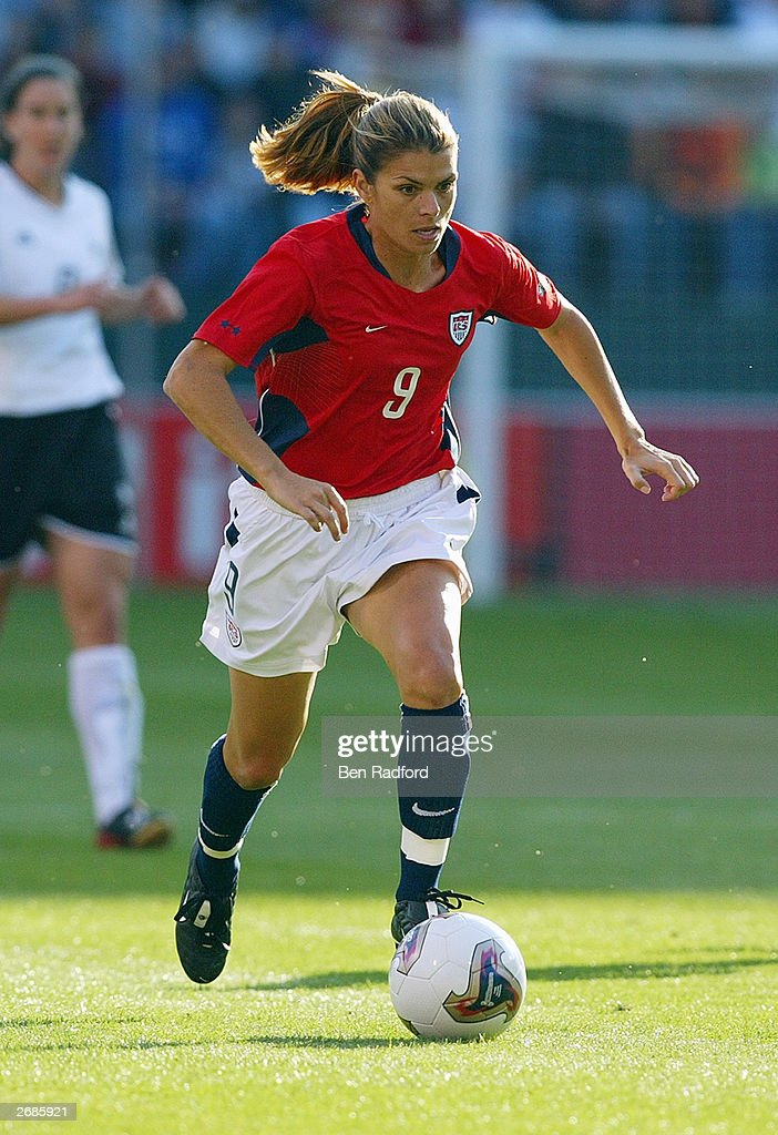 Mia Hamm #9 of the USA moves the ball forward against Germany during the semifinals of the FIFA Women's World Cup match on October 5, 2003 at PGE Park in Portland, Oregon. Germany defeated the U