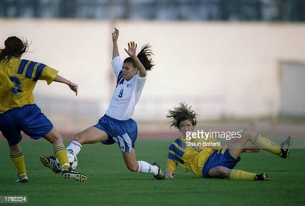 Mia Hamm of the USA slides on the field during an Algarve Cup game against Sweden. Mandatory Credit: Shaun Botterill /Allsport
