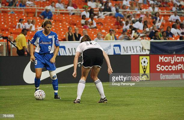 Mia Hamm of the Washington Freedom controls the ball as Christine McCann of the Boston Breakers defends in Hamm's first appearance this season due to...