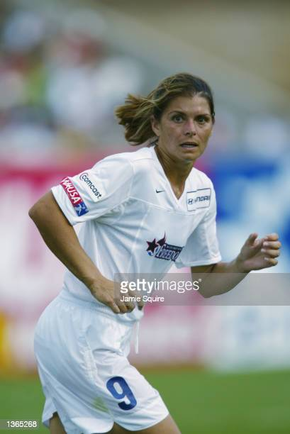 Mia Hamm of the Washington Freedom runs on the pitch during the WUSA Founders Cup II Championship game against the Carolina Courage on August 24 2002...