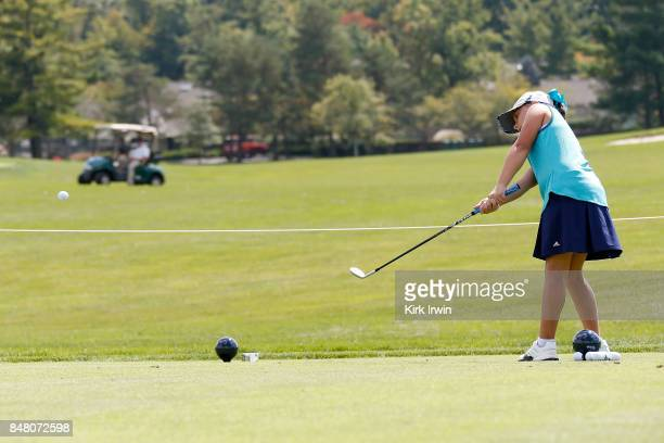 Mia Hammond hits a chip during the girls 10-11 chip competition during the Drive, Chip and Putt Championship at Muirfield Village Golf Club on...