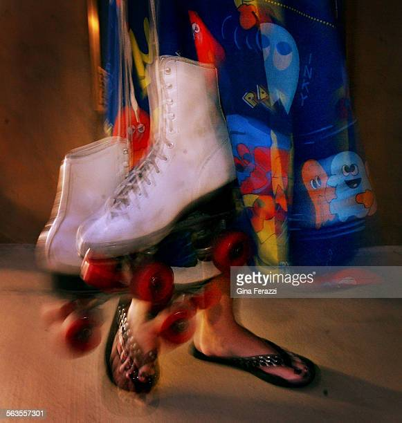 Mia Jenner of West Hollywood carries her roller skates to a singalong with the Xanadu movie at the John Anson Ford Amphitheatre July 18 2002