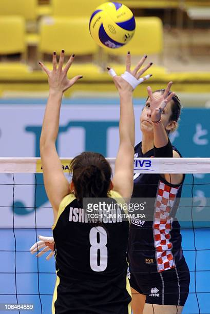 Mia Jerkov of Croatia pushes the ball above Kazakhstan's setter Korinna Ishimtseva during their final Pool C preliminary round match at the FIVB 2010...