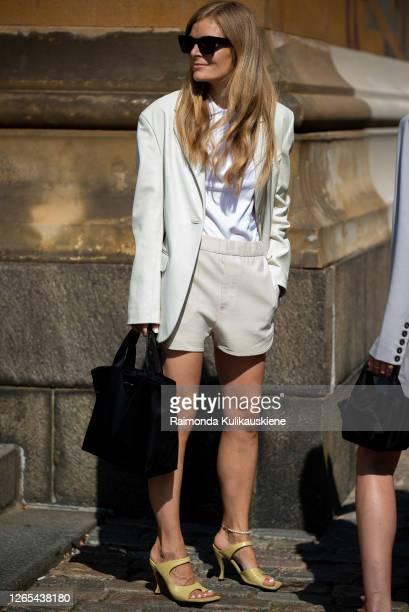 Mia Juel outside Remain Birger Christensen wearing ivory shorts and blazer during Copenhagen fashion week SS21 on August 11, 2020 in Copenhagen,...