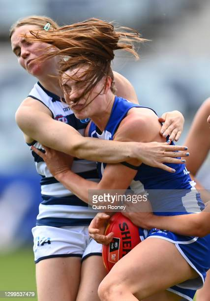 Mia King of the Kangaroos is tackled during the round one AFLW match between the Geelong Cats and the North Melbourne Kangaroos at GMHBA Stadium on...